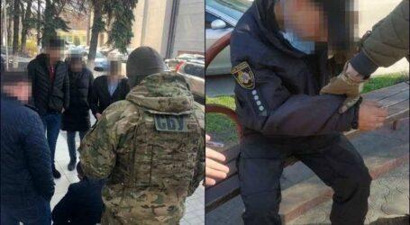 Поліцейські в Кам'янському підозрюються в роздаванні незаконних дозволів на зброю